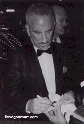 Don signing autographs at Hugh Hefner's birthday bash in 1999
